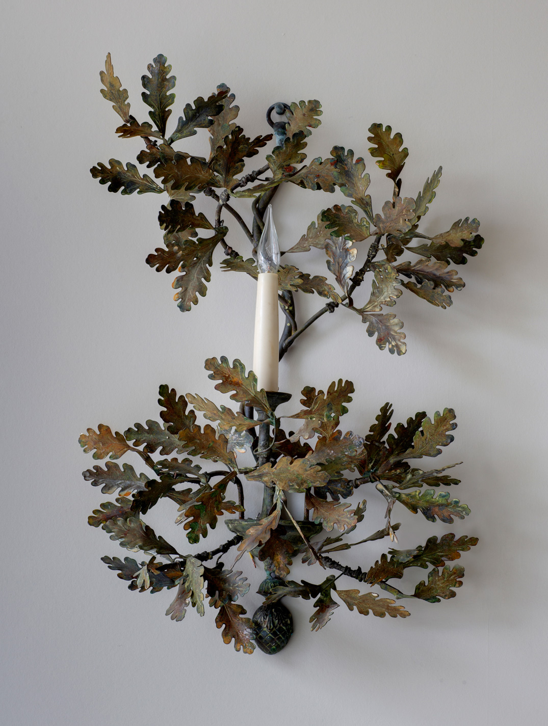 Single arm oak leaf wall light.