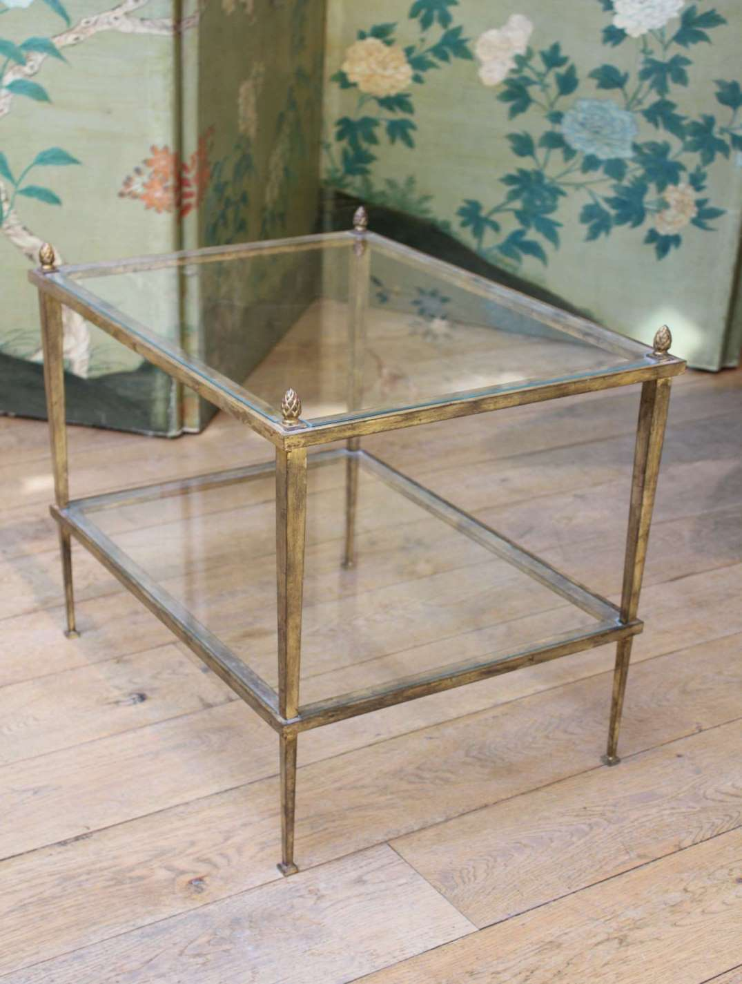 A custom made distressed gilded metal étagère.