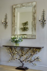 General shot of oak leaf console, panel framed mirror & Hanbury appliques