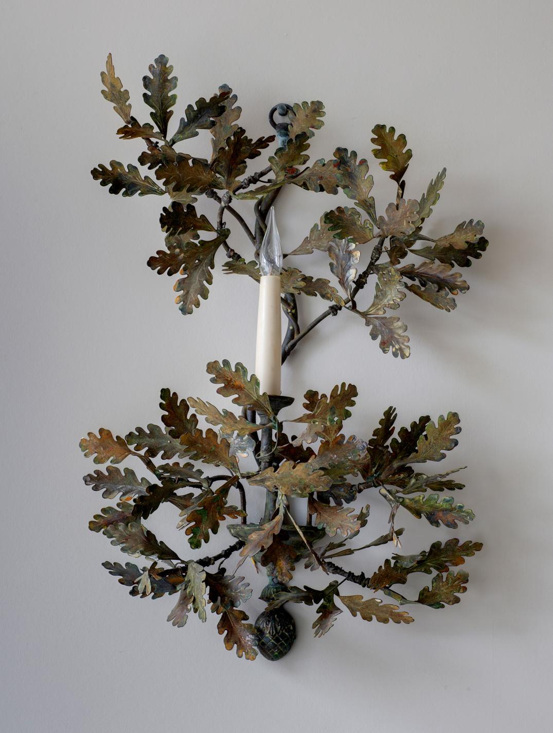 Single arm oak leaf wall light.