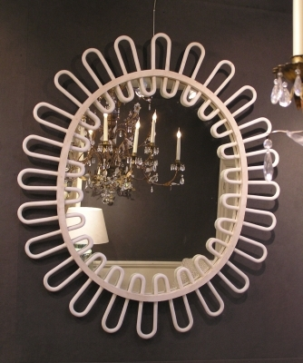Oval gessoed wooden mirror with looped frame.